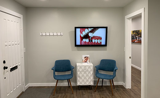 Dr Matthew Bender and Dr Scott Lewis at Meadowbrook Dental in Salt Lake City, Utah have a waiting room that has various seating options and a television that displays patient dental education videos